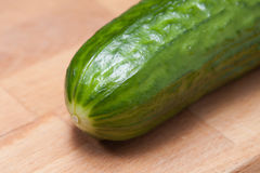 Cucumber on a cutting board. A cucumber on a cutting board Royalty Free Stock Image