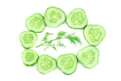 Cucumber slices and dill. Healthy food. Dill and slices of cucumber isolated Stock Photos