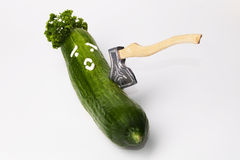 Cucumber with face and ax Stock Photography
