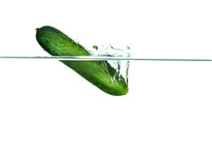 Cucumber falling into water with a splash. Green cucumber falling into water with a splash stock photos