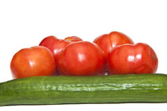 Cucumber and Five Tomatoes Royalty Free Stock Photo