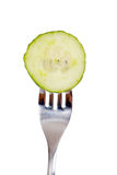 Cucumber on a fork Royalty Free Stock Photography