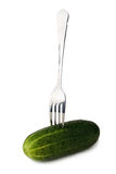 Cucumber on fork. Steel fork with fresh green cucumber on it Stock Images