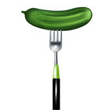 Cucumber on fork isolated on white Stock Photography