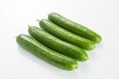 Cucumber. Fresh Green Cucumber Fruits on White stock photography