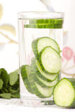 Cucumber in glass of water Royalty Free Stock Photos