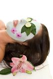 Cucumber and Green Tea Mask. A woman with green tea and cucumber mask Royalty Free Stock Images
