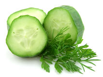 Cucumber with greens. Lobes of a cucumber with parsley and to fennel on a white background stock image