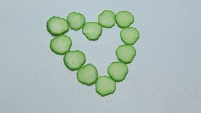 Cucumber heart symbol white background nobody. Studio stock video