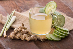 Cucumber and herbs juice. Combinating cucumber and herbs into juice for curing colds stock photography