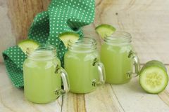 Cucumber juice. Fresh cucumber juice in jars Royalty Free Stock Image