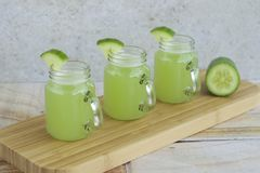 Cucumber juice. Fresh cucumber juice in jars Royalty Free Stock Photography