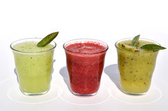 Cucumber, kiwi and raspberry juices Royalty Free Stock Photo