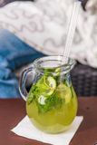 Cucumber lemonade in pitcher on table Royalty Free Stock Photos