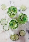 Cucumber and lime alcoholic cocktails on white marble surface Royalty Free Stock Image