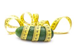 Cucumber with a measuring tape Royalty Free Stock Images
