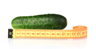 Cucumber with measuring tape Stock Photos
