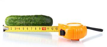 Cucumber with measuring tape Royalty Free Stock Photography