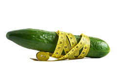Cucumber and measuring tape Stock Photo
