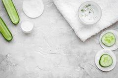 Cucumber moisturising cream or mask pattern. Grey background top view copyspace. Cucumber moisturising cream or mask. Grey background top view Stock Photo