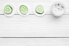 Cucumber moisturising cream or mask pattern. White wooden background top view copyspace. Cucumber moisturising cream or mask pattern. White wooden background top Royalty Free Stock Photos