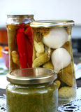 Cucumber and paprika pickled in the jar. Small cucumber and paprika (pepper) in the glass jar with aromatic vinegar. Stores for the winter Royalty Free Stock Image