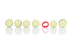 Cucumber and pepper pieces arranged on white background. Close up Royalty Free Stock Image