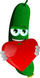 Cucumber or pickle holding a big red heart Royalty Free Stock Images