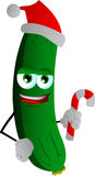 Cucumber or pickle holding a candy cane and wearing Santa's hat Royalty Free Stock Image