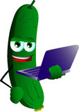 Cucumber or pickle holding laptop Stock Photography