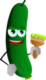 Cucumber or pickle holding a paint brush Stock Photos