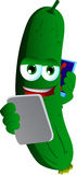 Cucumber or pickle speaking on a smartphone while reading a tablet Stock Photo