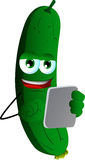 Cucumber or pickle using a tablet Stock Image