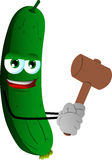 Cucumber or pickle with a wooden hammer Stock Photo