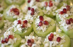 Cucumber Pomegranate and feta canapés Stock Photography