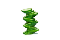Cucumber pyramid. Pyramid made of cucumber slices on white background, side view Royalty Free Stock Images