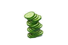 Cucumber pyramid. A pyramid made of cucumber slices on white background, upper view Royalty Free Stock Photos