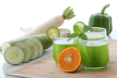 Cucumber, radish, paprika and orange juice mix Stock Photography
