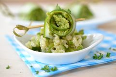 Cucumber roll on salad. Stuffed cucumber roll on quinoa salad Royalty Free Stock Photos