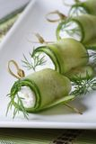 Cucumber rolls with cream cheese and dill vertical Royalty Free Stock Photo