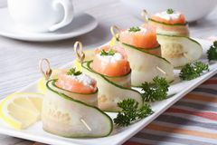 Cucumber rolls with salmon, cream cheese closeup horizontal Stock Images