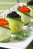 Cucumber rolls with salmon red and black sturgeon caviar Stock Image