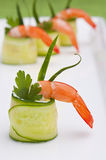 Cucumber rolls with shrimp. For party Stock Photo