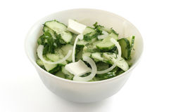 Cucumber salad. In a bowl stock photography