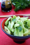 Cucumber salad. Chinese-style on a red background royalty free stock photos