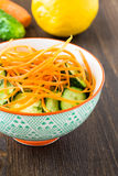 Cucumber salad with carrot in bowl Stock Photo