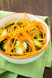 Cucumber salad with carrot in bowl Royalty Free Stock Image