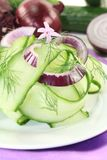 Cucumber salad with garlic flower Royalty Free Stock Images