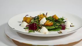 Cucumber salad with grilled tuna. Arugula and Beet Salad with Goat Cheese and Candied Nuts. Salad of lettuce, beetroot