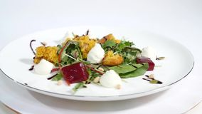Cucumber salad with grilled tuna. Arugula and Beet Salad with Goat Cheese and Candied Nuts. Salad of lettuce, beetroot. And salmon fillets with a delicate cream stock footage